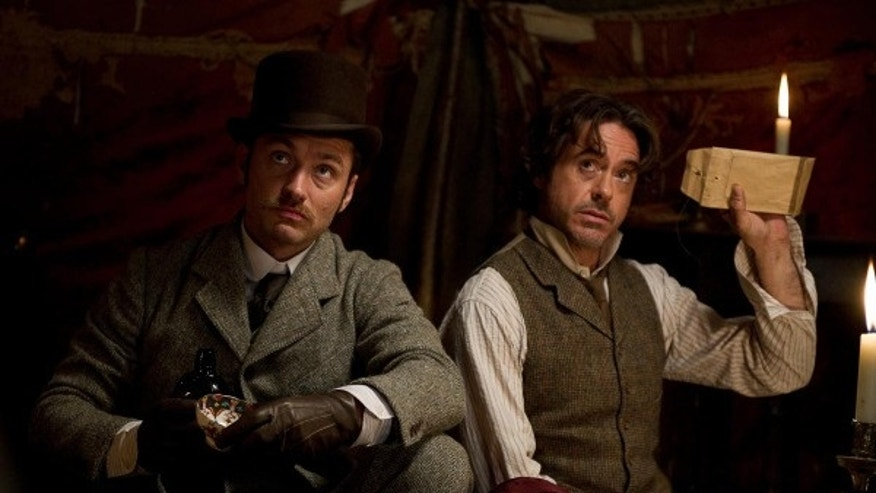 "Robert Downey, Jr., right, and Jude Law star as Sherlock Holmes and Dr. Watson in ""Sherlock Holmes: A Game of Shadows."" (Warner Bros. 2011)"