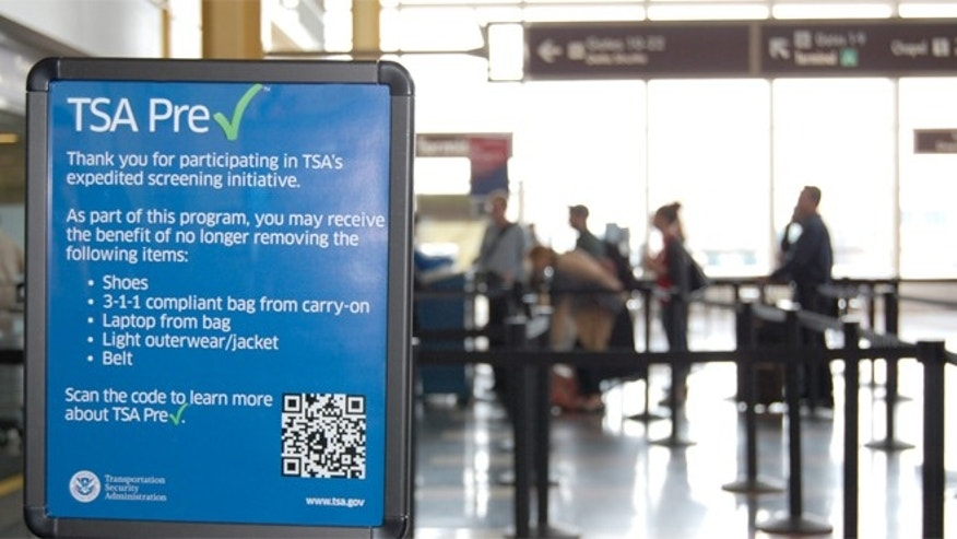 A sign listing the benefits of the TSA PreCheck security program. (AP)