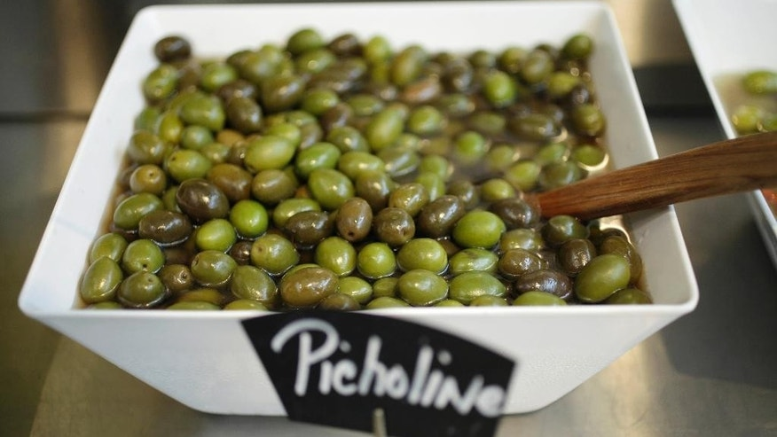 A bowl of Picholine olives are displayed at the Olive Press tasting room in Napa, Calif.