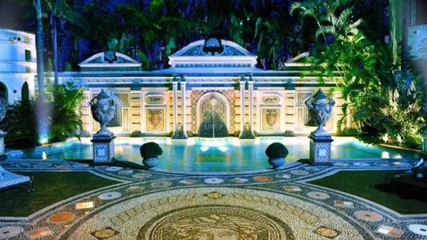 The opulent courtyard features a pool tiled with mosaics and 24-carat gold.