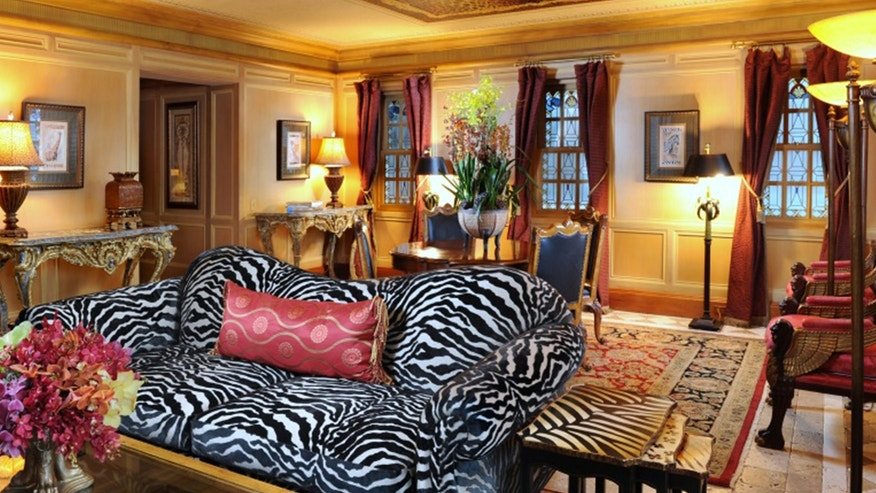 Luxury suites feature signature Versace style.