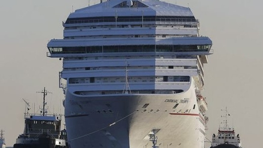 FILE: The Carnival Triumph being towed into Mobile Bay near Dauphin Island, Ala., after being damaged by an engine room fire.