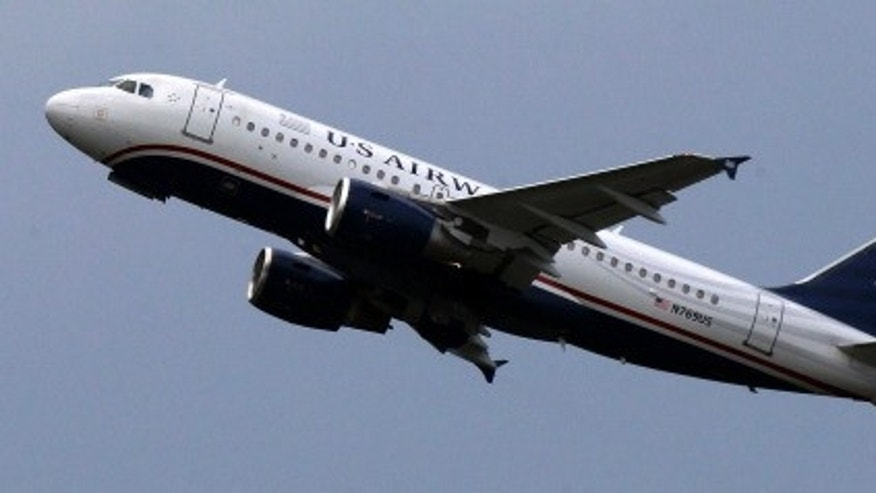 HOLD FOR BUSINESS PHOTO-- This is a US Airways jet taking off from Pittsburgh International Airport on Tuesday, July 23, 2013 in Imperial, Pa. (AP Photo/Gene J. Puskar)