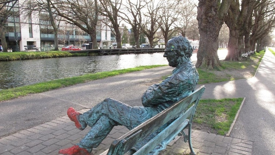 A bronze depiction of poet Patrick Kavanagh sitting by the Grand Canal in Dublin, Ireland.