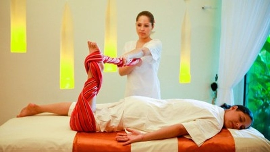 Relaxing with a massage at the Grand Velas Riviera Maya Spa.