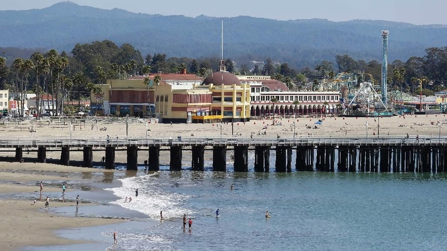 April 7, 2014: The beach with the hundred-year-old wharf and Santa Cruz Beach Boardwalk in the background in Santa Cruz, Calif.