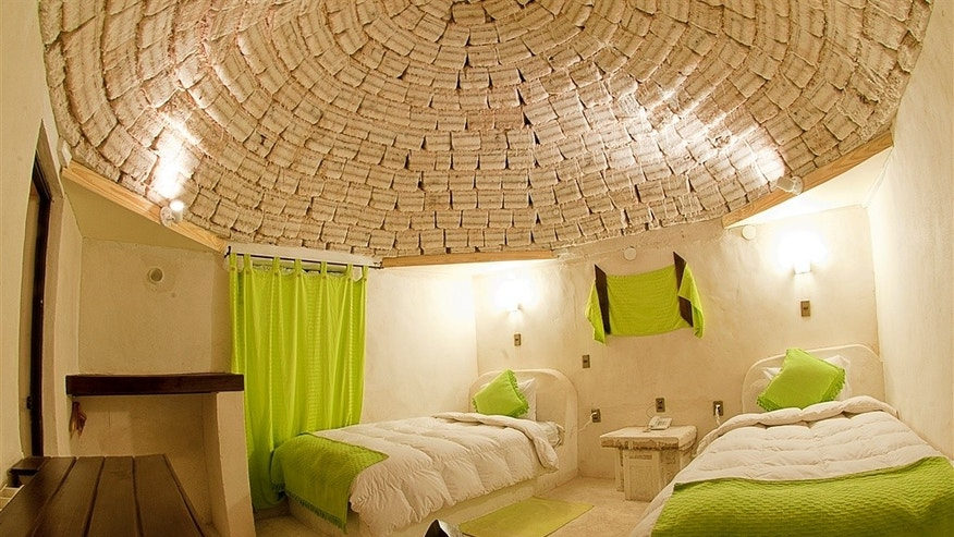 Bedrooms feature a signature dome of salt blocks.