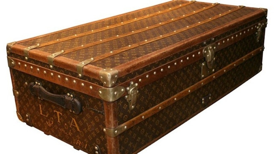 In the mid 1850s, Louis Vuitton introduced his pioneering slat trunk, which was covered in canvas sheathing, held well-designed drawers and had a flat top that made stacking much easier.