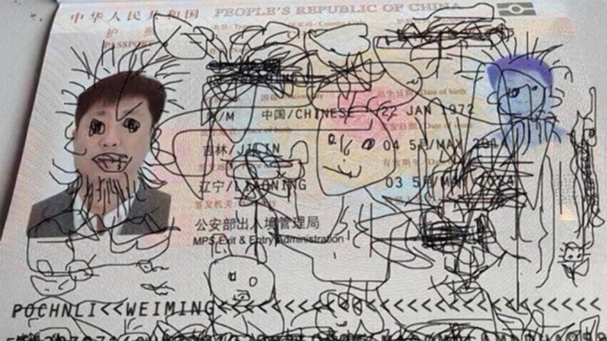 A four-year-old boy's drawing on his dad's passport has left the man stranded in South Korea and unable to get home to China.