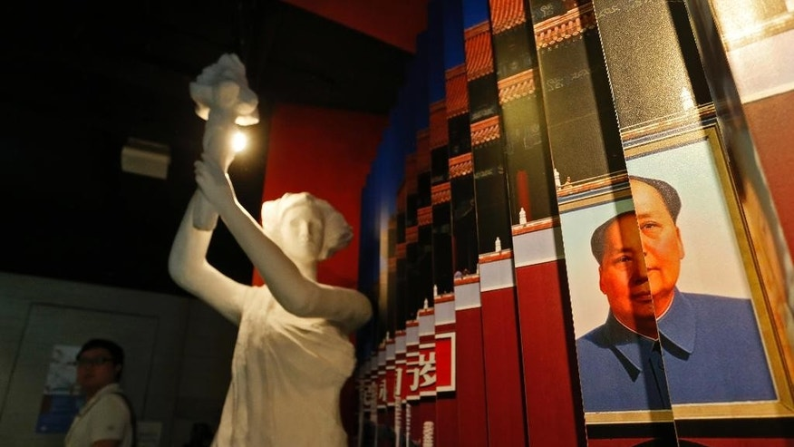The Goddess of Democracy and a portrait of the late Communist leader Mao Zedong are displayed at the June 4th Museum in Hong Kong.