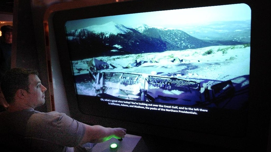 A simulator of a snowcat driving up the Mount Washington Auto road is used at the new Extreme Museum on the top of Mount Washington.