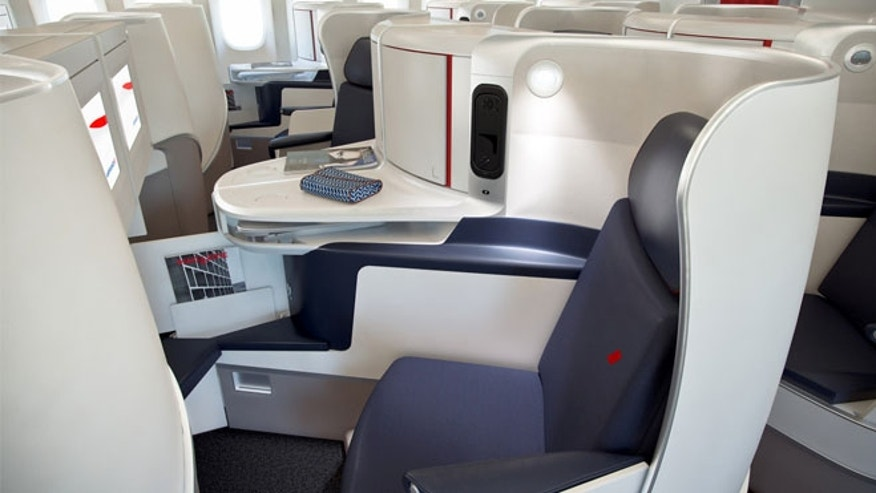 Business class seats have  privacy screens and are in a 1-2-1 configuration giving each passenger access to the aisle.