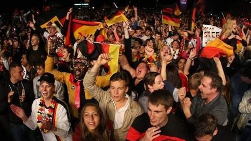 German fans celebrate their victory.