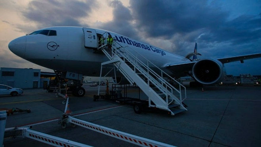 July 28, 2014: Lufthansa 777 cargo plane stands on the tarmac in Frankfurt. the company has said it would suspend overflights and halt operations to the northern city of Erbil.