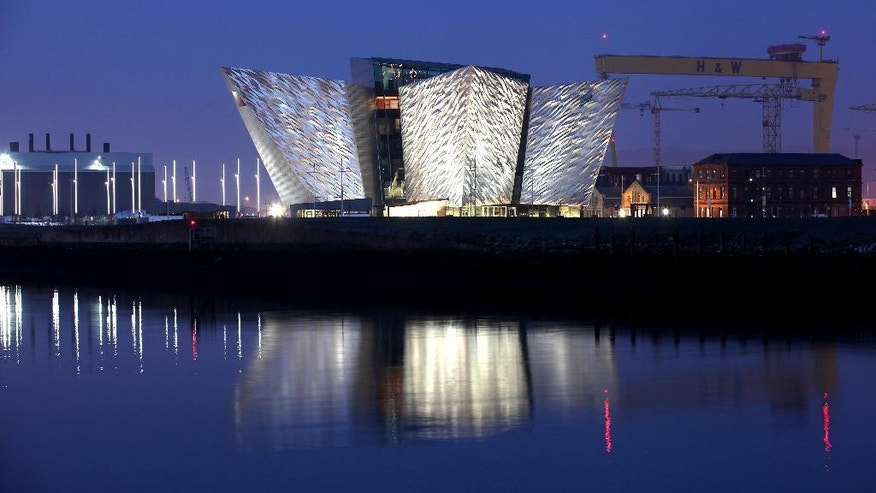 FILE -The Titanic House Visitor Centre is reflected on Belfast Lough, Northern Ireland.