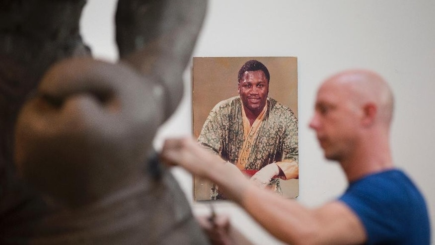 In this Aug. 14, 2014 photo, artist Stephen Layne works on a sculpture of boxing heavyweight champion Joe Frazier in Philadelphia.
