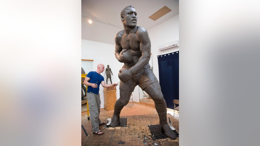 In this Aug. 14, 2014:  Next year, the sculpture is expected to be placed near the city's sports stadiums, ending a hurdle-strewn saga that included fundraising problems and the death of the original sculptor.