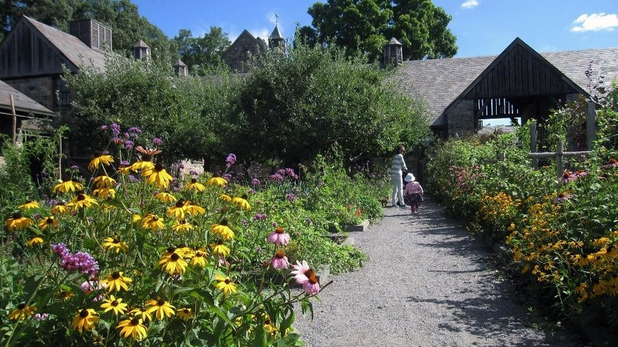 Aug. 15, 2014: Visitors walk through a flower garden at Stone Barns, a nonprofit working farm in Pocantico Hills, N.Y., dedicated to education and conservation.