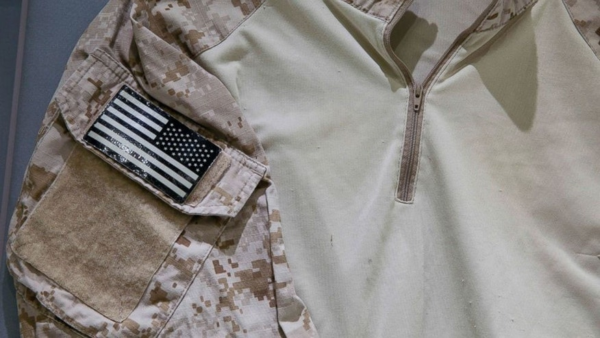 Sept. 5, 2014: The fatigue shirt worn by the U.S. Navy SEAL during the mission to capture Osama bin Laden, is seen in a case at the museum in New York. The shirt joins other items donated to the museum by persons involved with the mission.