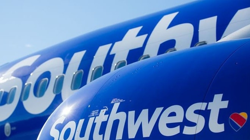 Southwest has a new logo and colors and planes with be a darker blue with new lettering on the fuselage and hearts painted on their undersides.