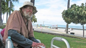 Sept. 8, 2014: Jim Trevarthen, 62, is one of many homeless people who is unhappy with the city's proposals to ban sitting and lying down on sidewalks in the tourist mecca.