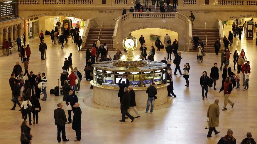 FILE: Pedestrians and travelers stroll through the main concourse of Grand Central Terminal in New York.