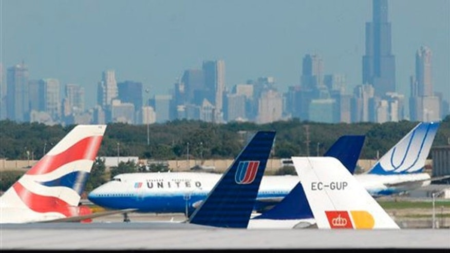 FILE: Aircraft wait to take off at O'Hare International Airport in Chicago.