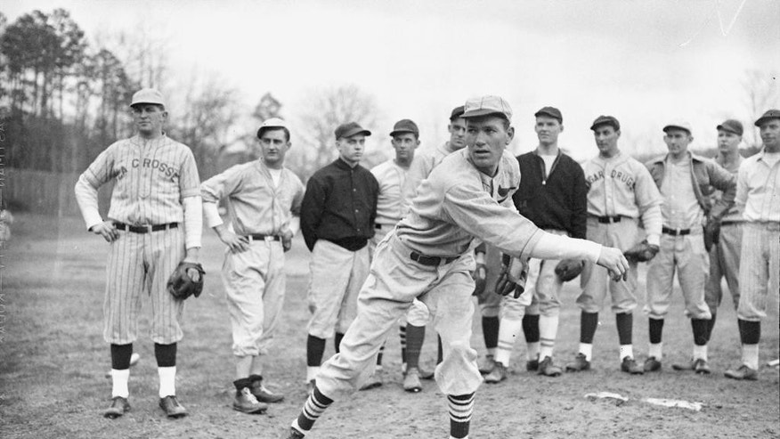 FILE -Dizzy Dean gives a group of rookies a pitching lesson at a baseball school in Hot Springs, Ark.