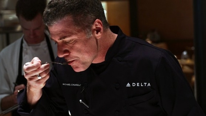 Chef Michael Chiarello samples a dish for Delta's revamped in-flight dining options.