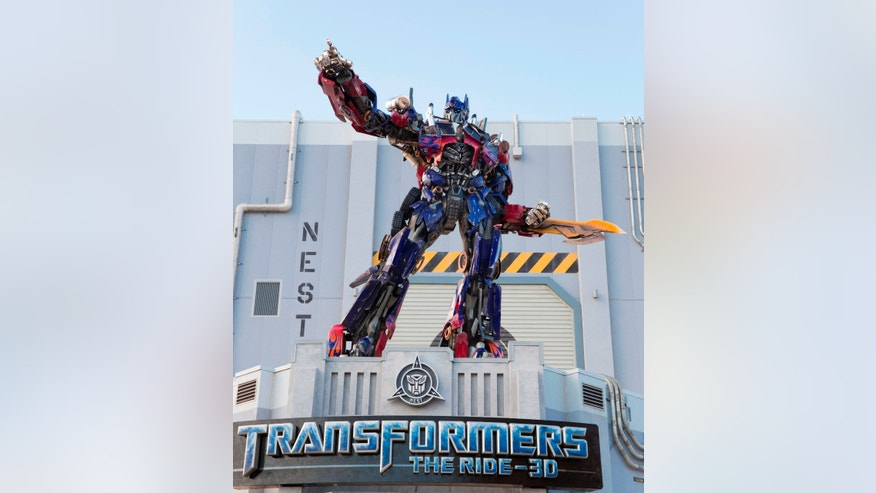 Optimus Prime towers above the entrance to Universal Orlando Resort's blockbuster attraction, TRANSFORMERS: The Ride – 3D.