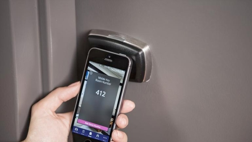 The SPG Keyless app will require guests to touch their smartphone to a pad on door to unlock the room.