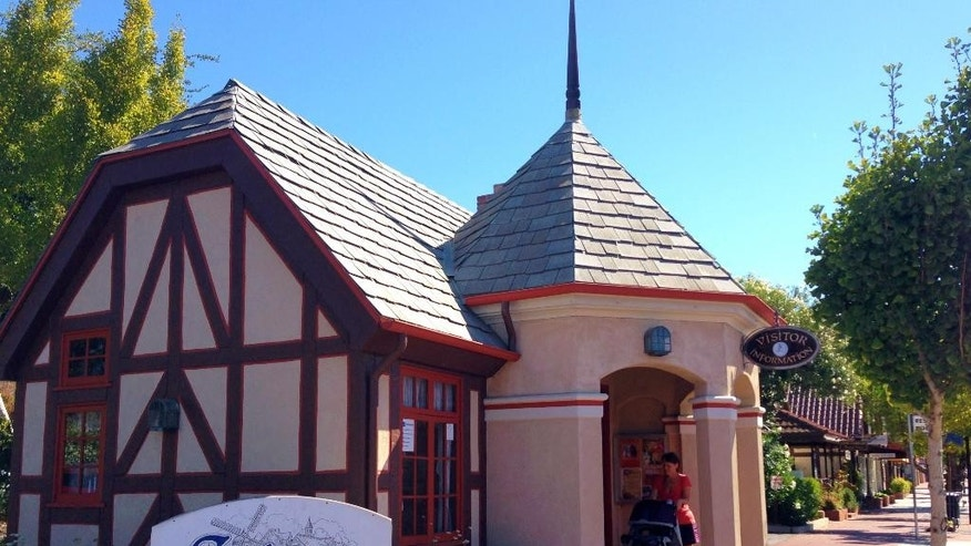 This Oct. 1, 2014 photo shows the Solvang Visitors Bureau in Solvang, Calif. Founded in 1911 by Danish immigrants, Solvang is a touristy enclave with Danish bakeries and Danish-themed hotels in addition to the Hans Christian Andersen Museum. (AP Photo/Solvej Schou)
