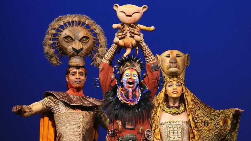 "Disney Theatrical Group shows, from left, Nathaniel Stampley as Mufasa, Tshidi Manye as Rafiki, and Jean Michelle Grier as Sarabi, in Disney's ""The Lion King."""