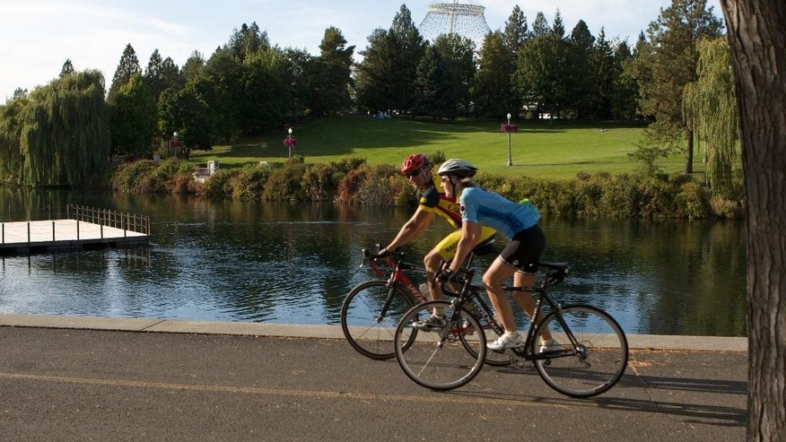 Bike riders along a section of the Centennial Trail, a 60-mile  paved biking and hiking trail that connects Spokane, Wash., with Coeur d'Alene, Idaho.