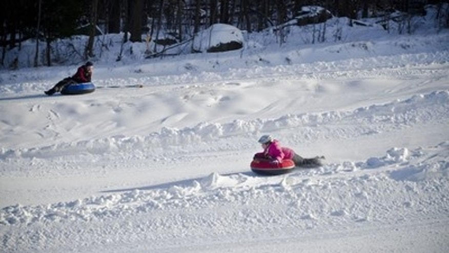 Little ones and adults alike enjoy snow tubing at Spring Mountain Adventures in Schwenksville, Pa.