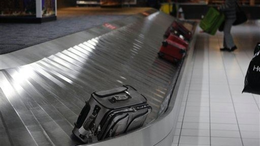 In this Oct. 27, 2009 file photo, a piece of luggage is seen on a baggage carousel.