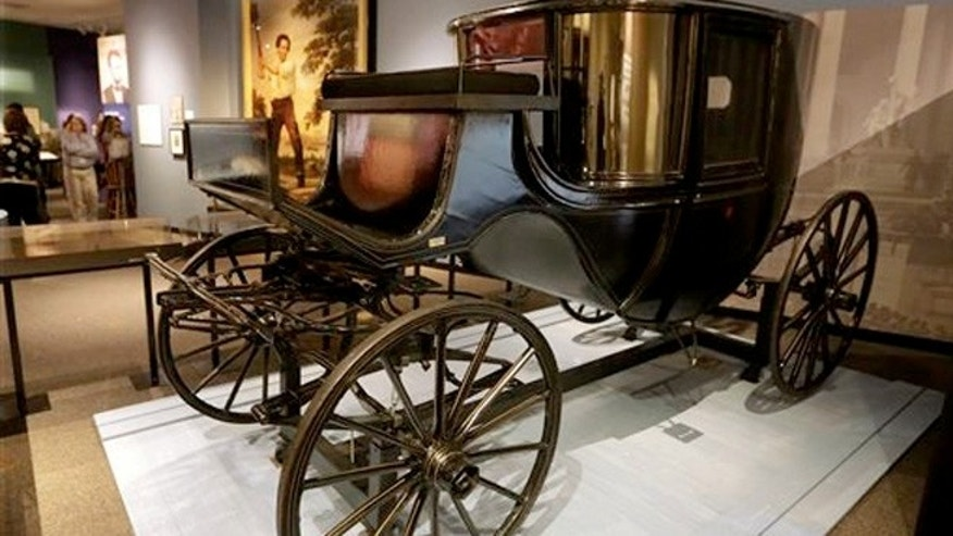 Abraham Lincoln and his wife Mary's carriage are on display as part of the Undying Words exhibit during an announcement of the schedule of events and activities for next year to mark the 150th anniversary of the end of slavery, the conclusion of the Civil War and the death of Abraham Lincoln.