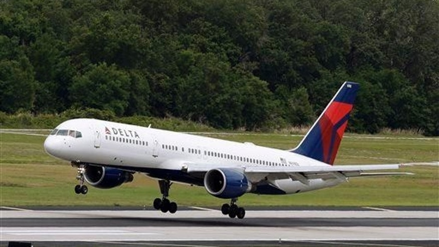 In this Thursday, May 15, 2014, file photo, a Delta Air Lines Boeing 757-232 lands at the Tampa International Airport in Tampa, Fla.