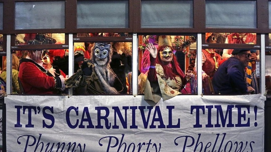 Jan. 6, 2015: The Phunny Phorty Phellows, celebrating aboard a streetcar in New Orleans. King's Day is a  tradition marking the 12th night after Christmas and the official start of the Mardi season.