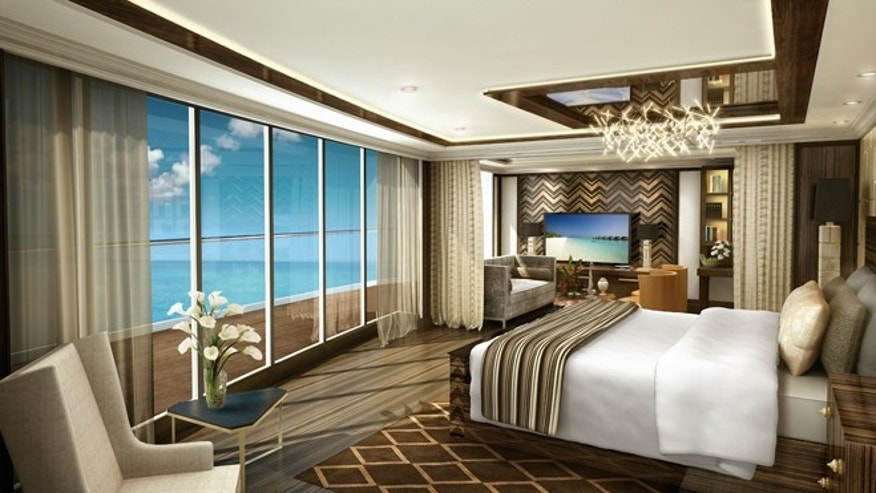 Seven Seas Explorer's Regent Suite has floor-to-ceiling windows in its master bedroom that is decorated with glass, polished metals, exotic woods.