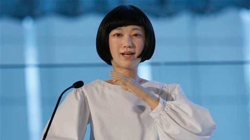 Android robot Kodomoroid speaks during a press event at the National Museum of Emerging Science and Innovation Miraikan in Tokyo Tuesday, June 24, 2014.