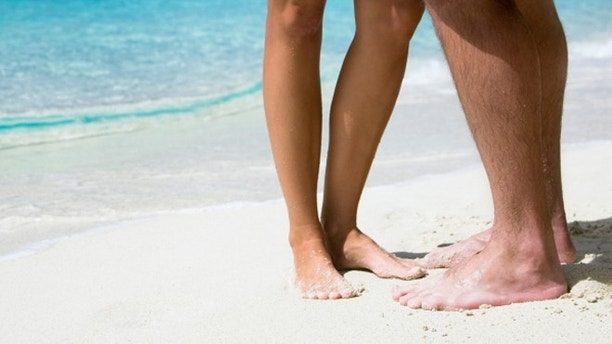 honeymoon couple hugging at the paradise beach in the Caribbean