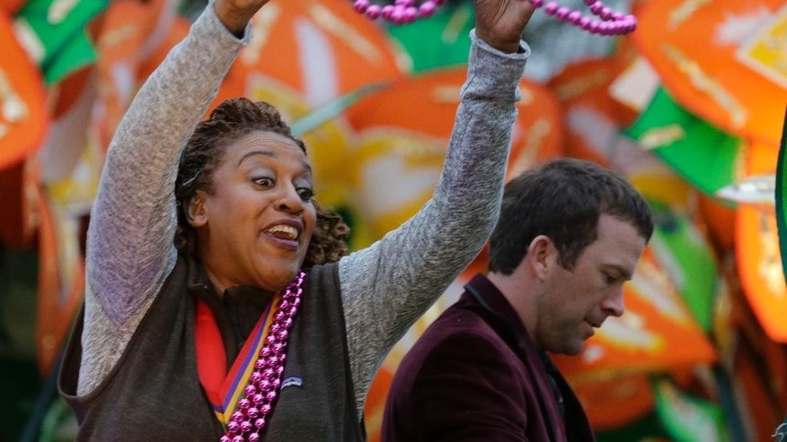 CCH Pounder, actress on the television series NCIS New Orleans, throws beads from a float during the Krewe of Proteus parade in New Orleans, Monday, Feb. 16, 2015. The day is known as Lundi Gras, the day before Mardi Gras. (AP Photo/Gerald Herbert)