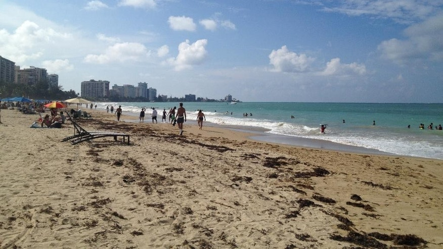 Oct. 2014: Beachgoers enjoy the sun and sand at Isla Verde Beach in San Juan, Puerto Rico.
