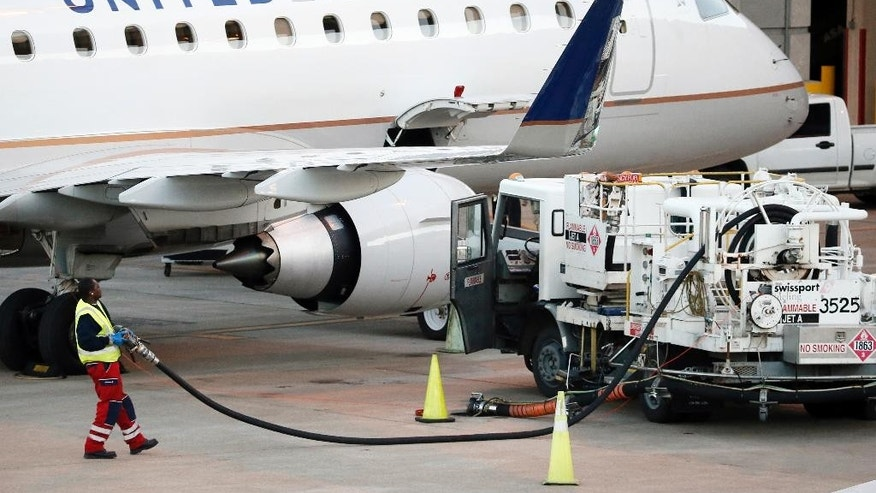 Jan. 15, 2015:  A worker prepares to fuel a United Express aircraft after it arrived at Dallas-Fort Worth International Airport.  Many of the incidents in the memo were direct results due to pilots and crew not speaking up in the event of an unsafe situation.