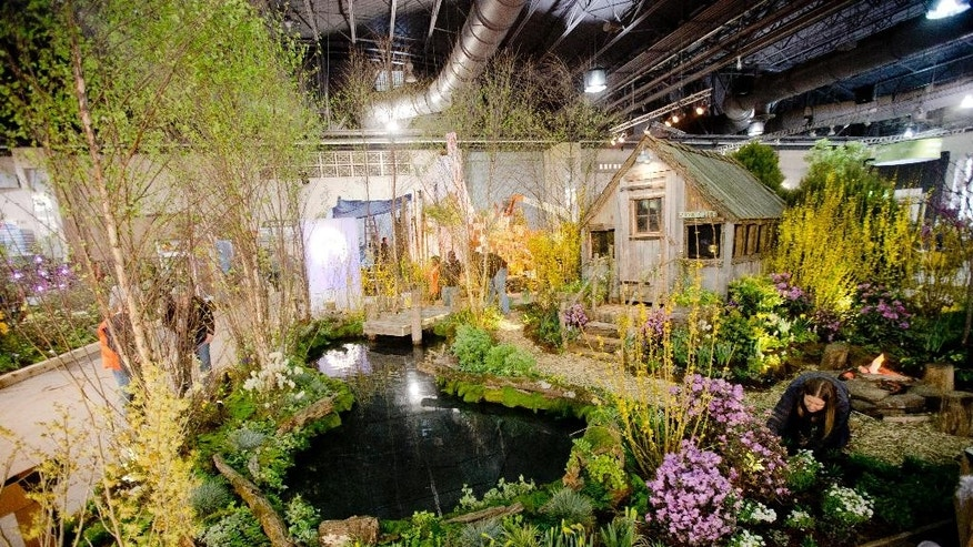 Workers make preparations for the Philadelphia Flower Show, Thursday, Feb. 26, 2015, at the Pennsylvania Convention Center in Philadelphia. The horticultural extravaganza is scheduled to run from Feb. 28 to March 8. (AP Photo/Matt Rourke)
