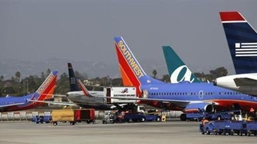 Airplanes converge at gates on the tarmac of Los Angeles International Airport.