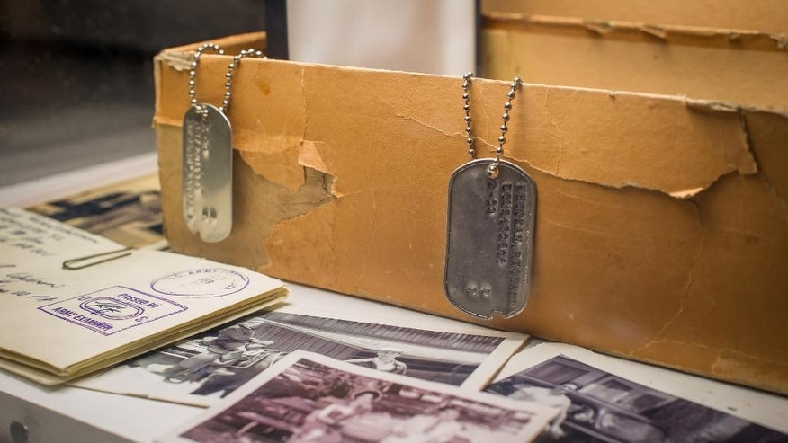 March 10, 2015:  Don Draper's box of secrets, including Dick Whitman's dogtag, letters, and family photos are displayed as part of the exhibition.