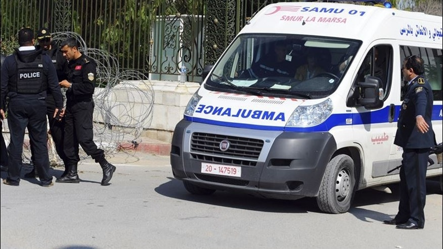 An ambulance leaves the National Bardo Museum yesterday afternoon in Tunis, Tunisia after gunmen opened fire.