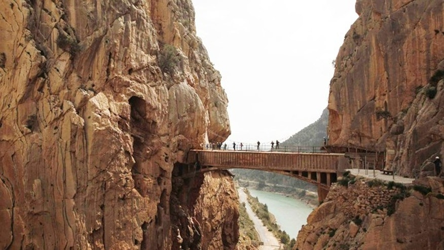 Journalists walk along the new Caminito del Rey in El Chorro-Alora, near Malaga, southern Spain ahead of its grand re-opening in late March.